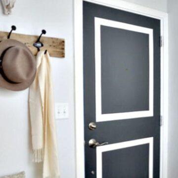 DIY coat hook and gray front door in entryway
