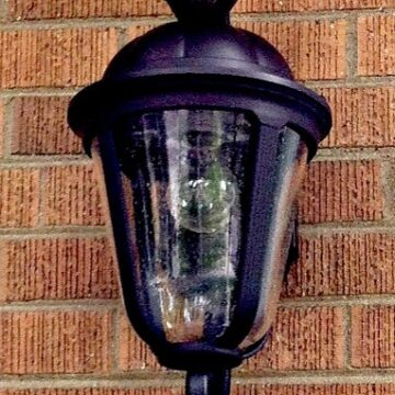 motion light hanging on a brick house