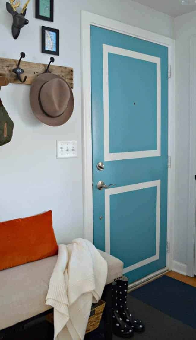 Painting faux molding on a plain front door | chatfieldcourt.com