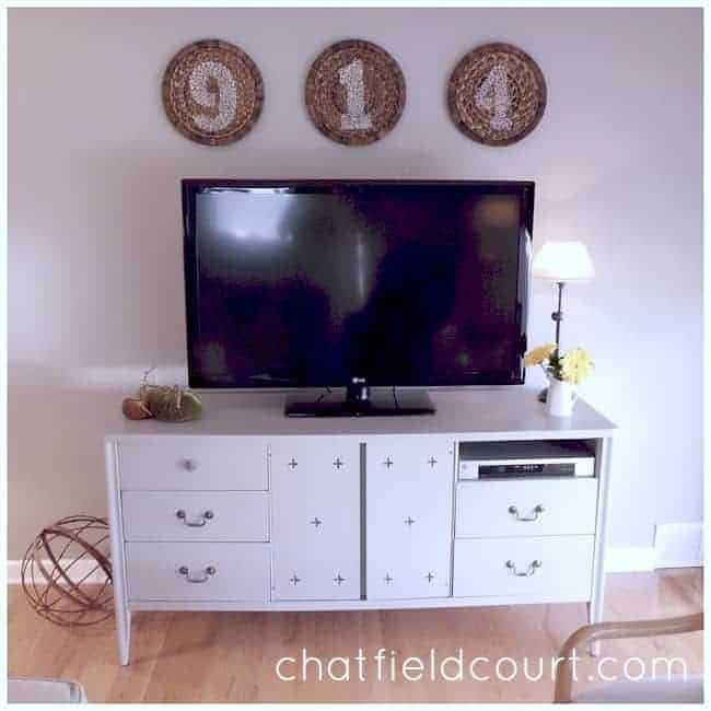 Benjamin Moore Hale Navy and brass hardware transform a vintage dresser turned media cabinet. | chatfieldcourt.com