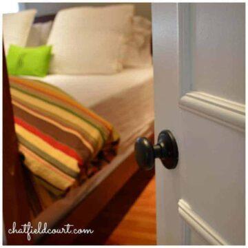 A close up of a bedroom door knob