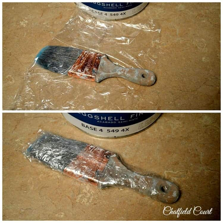used paint brush wrapped in Saran wrap