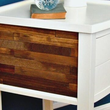 Closeup of a wood and white nightstand