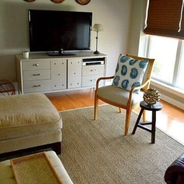 A living room with a couch and a television