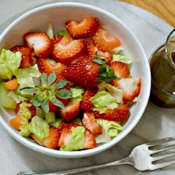 green salad with strawberries and homemade balsamic dressing