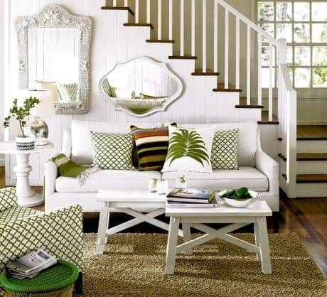 small living room with white sofa and green accents