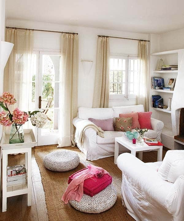 small living room with white sofas and large windows