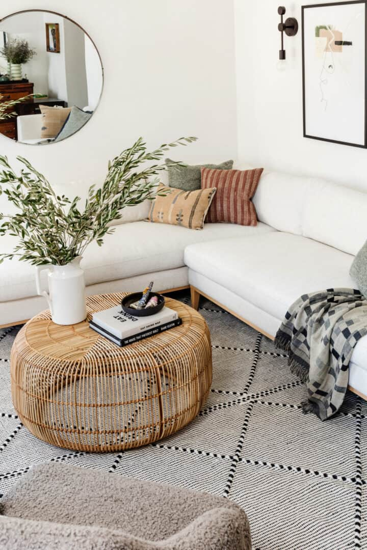 living room with white sofa and mirror
