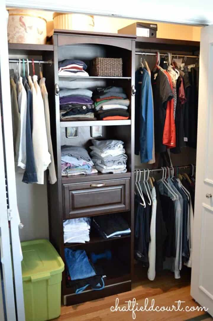 store bought closet system in small master closet