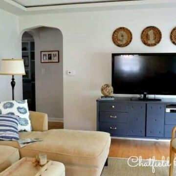 A living room filled with furniture and a large TV