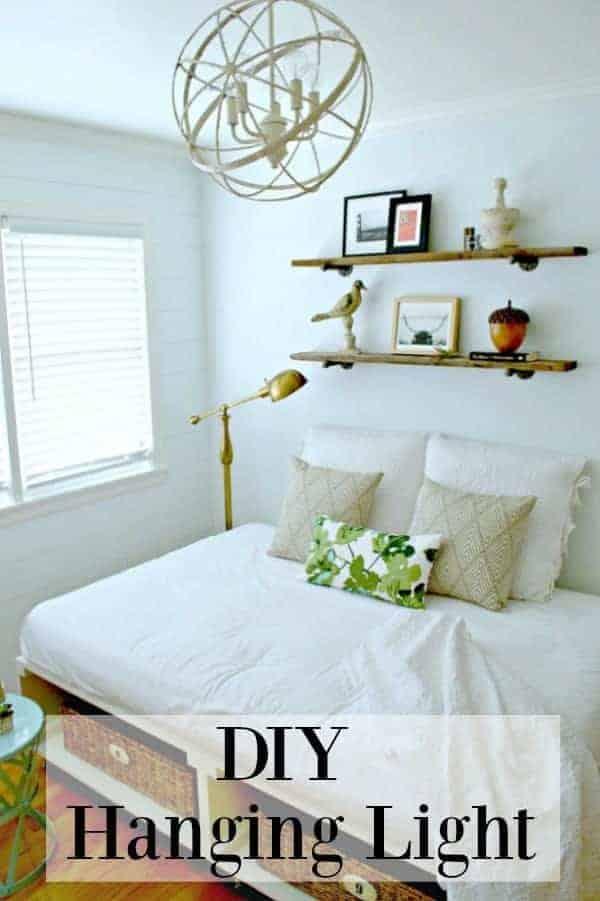 DIY hanging light fixture in white guest bedroom