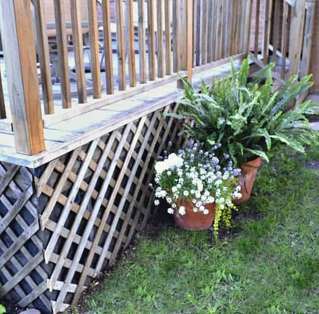 lattice under a deck with pots of flowers