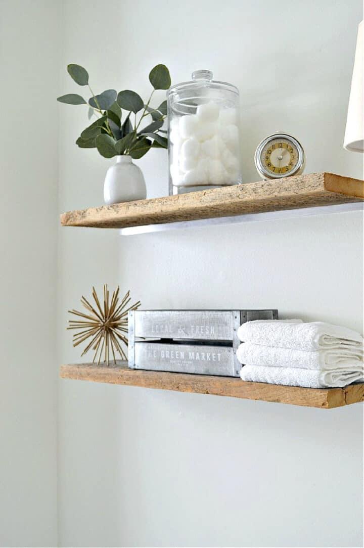 wood shelves on bathroom wall with toiletries