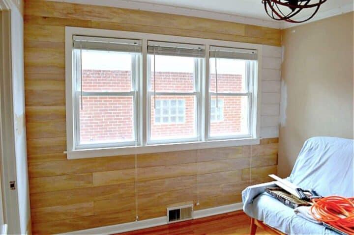 unpainted DIY shiplap wall in a guest bedroom