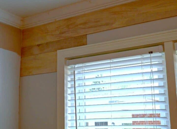 installing a shiplap wall in a bedroom