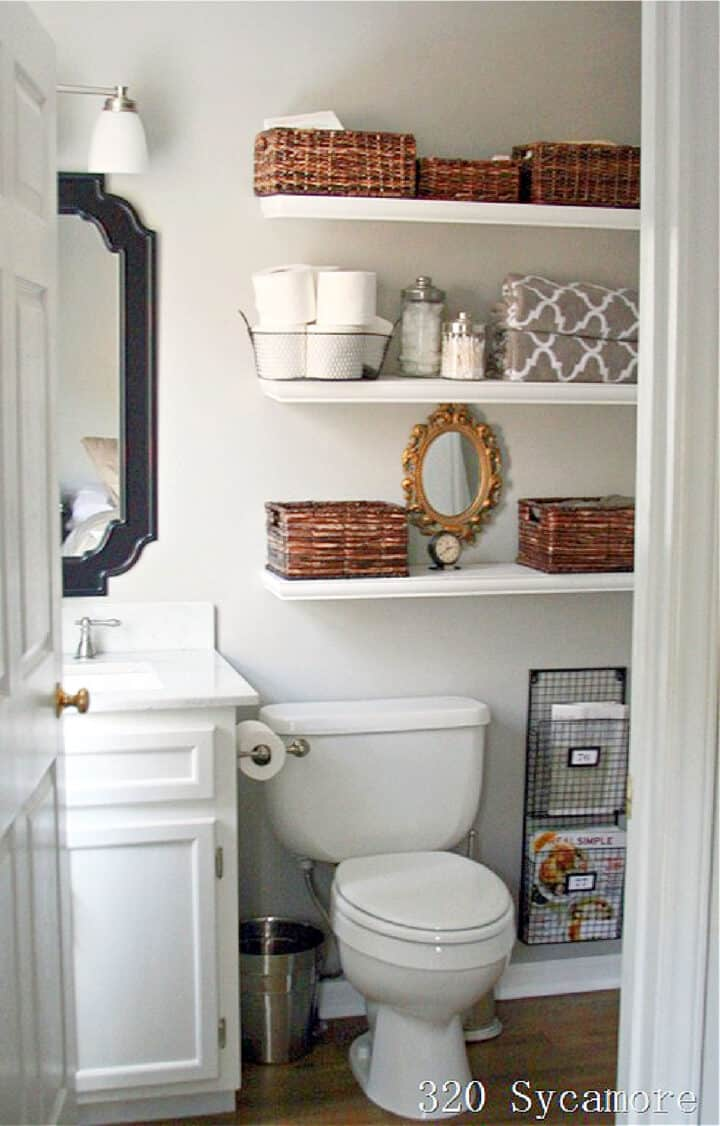 bathroom shelves in small bath filled with baskets and toiletries