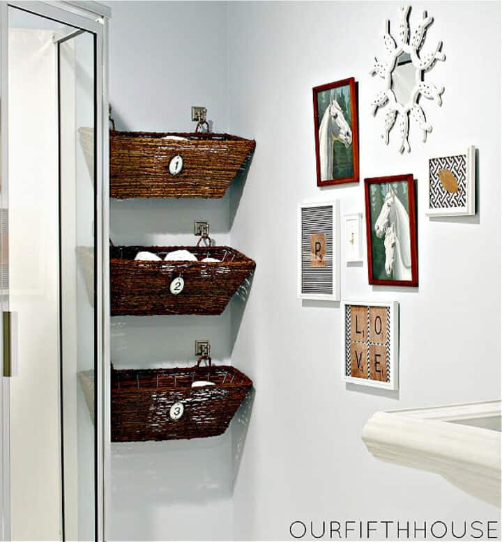woven baskets hanging on bathroom wall with toiletries