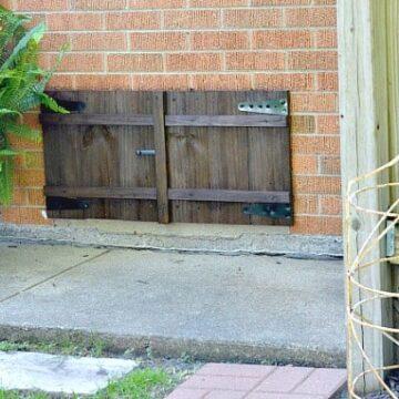A wood shutter on a house