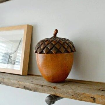barn wood shelf with wooden acorn on it