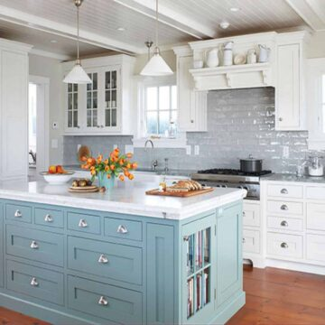 ceiling beams in white kitchen with blue island