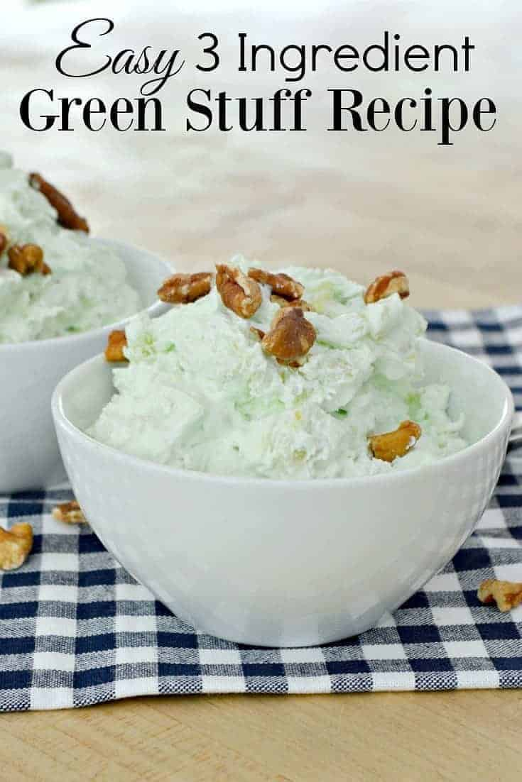green stuff in white bowl with chopped pecans on top