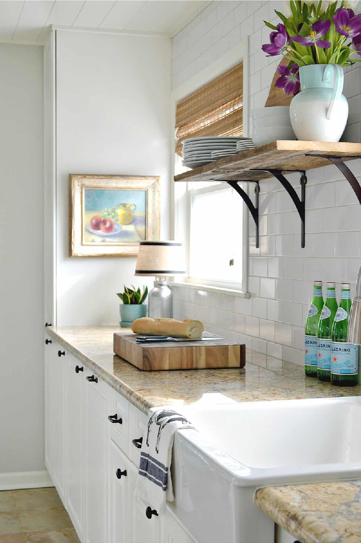 galley kitchen cabinets painted white with granite countertops
