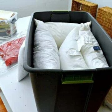 A bin of feather pillows