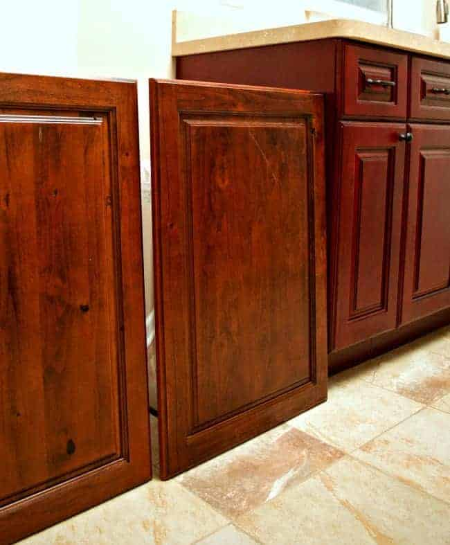 A kitchen storage solution...hidden trash and recycle bins in a custom-made cabinet. | chatfieldcourt.com