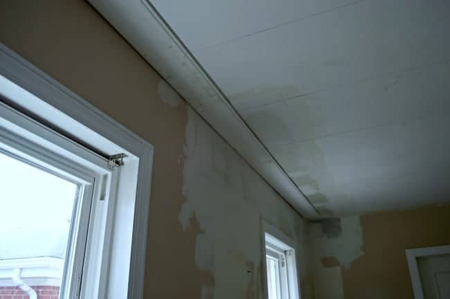 one primed tongue and groove ceiling plank installed in kitchen