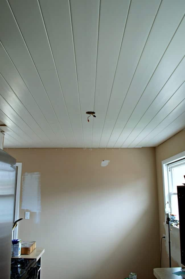 installed and painted tongue and groove ceiling planks in kitchen