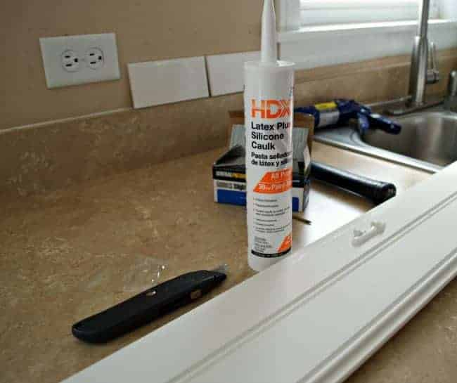 tube of caulk used to install plank ceiling