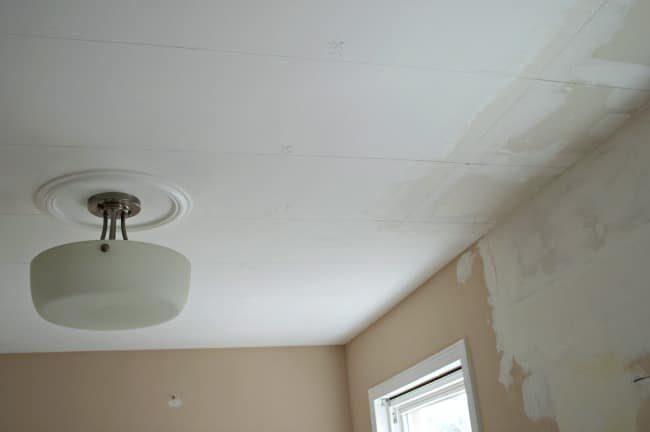 white kitchen ceiling with ceiling light