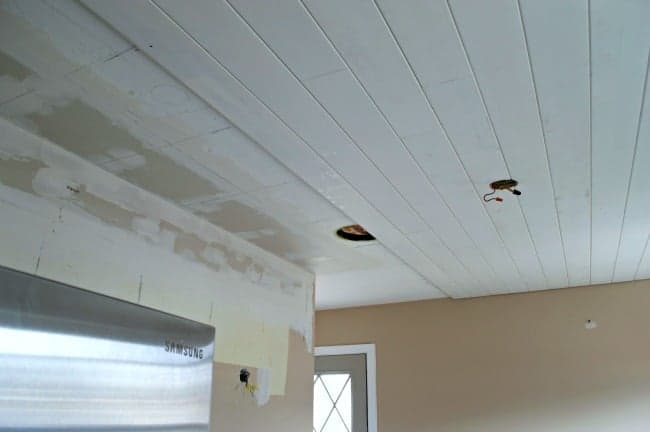 tongue and groove planks installation in kitchen ceiling