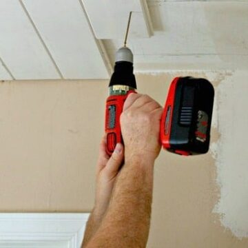 Screwing planks on ceiling