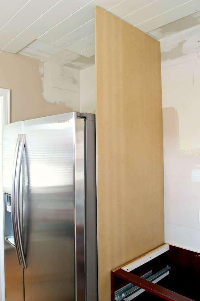 panel of MDF installed next to refrigerator
