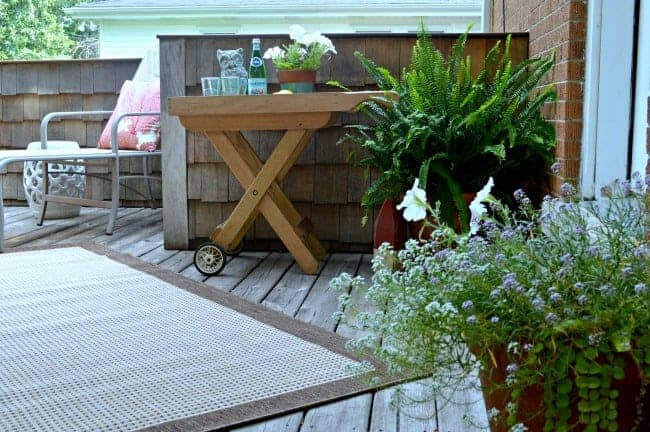 Small But Beautiful Outdoor Spaces - small deck with space to lounge with a cool drink