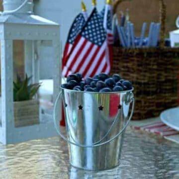 Tin bucket of blueberries