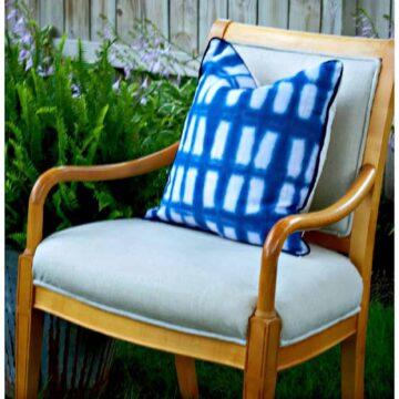 DIY no sew tie dye pillow on beige armchair