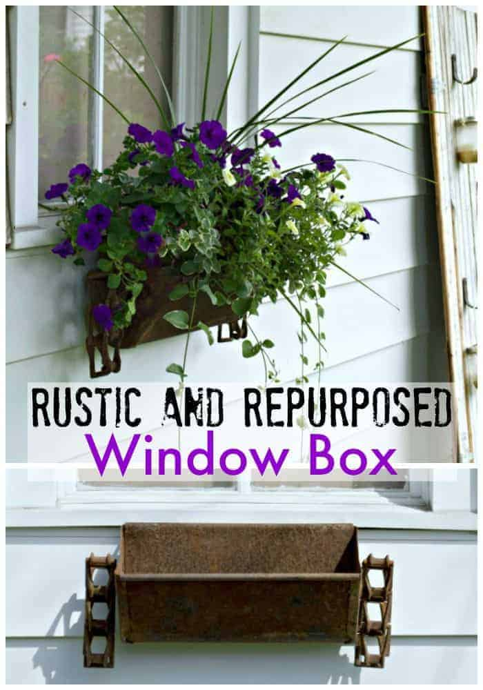 rustic window box hanging on garage window with petunias and trailing vines