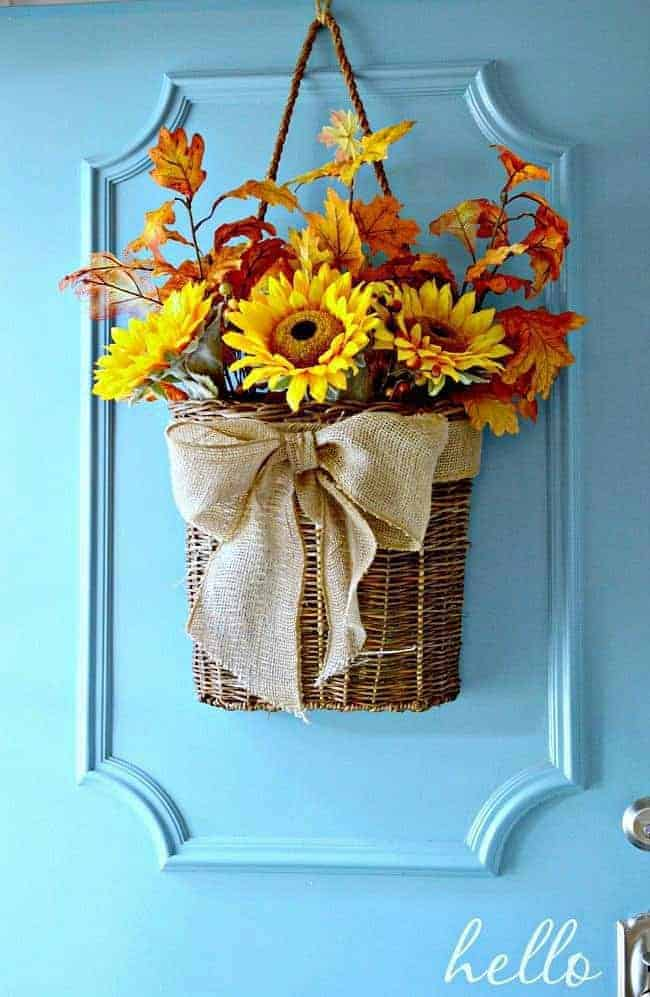 How to create an easy DIY fall front door basket with leaves and sunflowers.