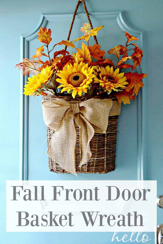 fall front door basket wreath hanging on turquoise front door