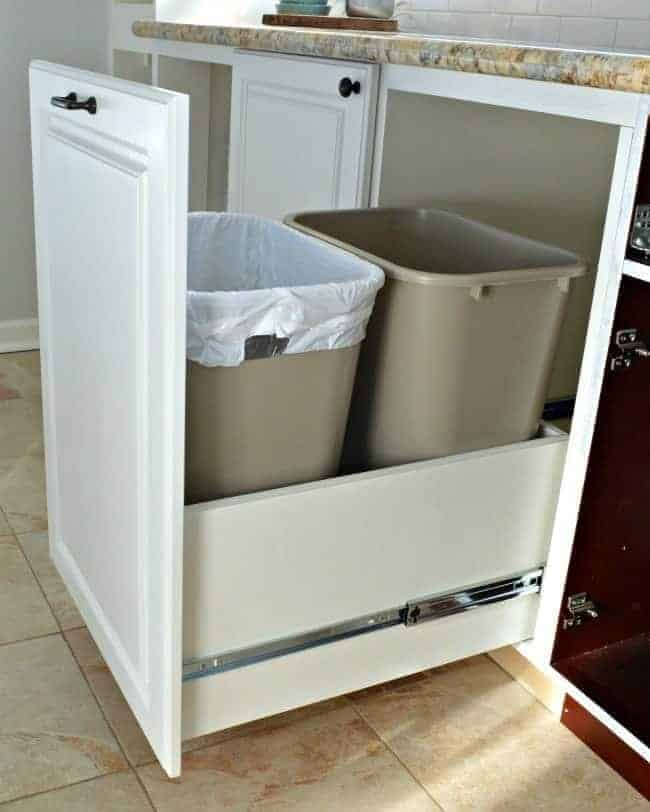 A genius kitchen storage solution...hidden trash/recycle bins with full extension drawer slides | chatfieldcourt.com