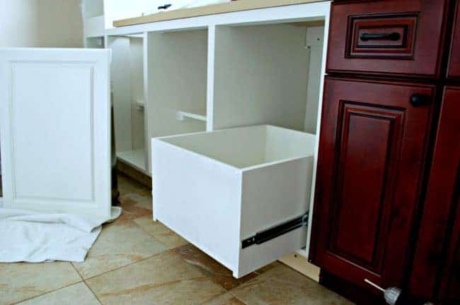 A genius kitchen storage solution...hidden trash and recycle bins in a custom-made cabinet. | chatfieldcourt.com