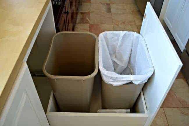 A genius kitchen storage solution...hidden trash and recycle bins. | chatfieldcourt.com