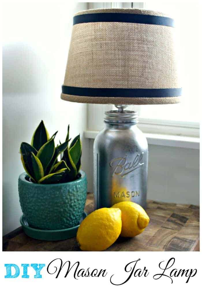 DIY Mason Jar Lamp on cutting board with potted plant and lemons