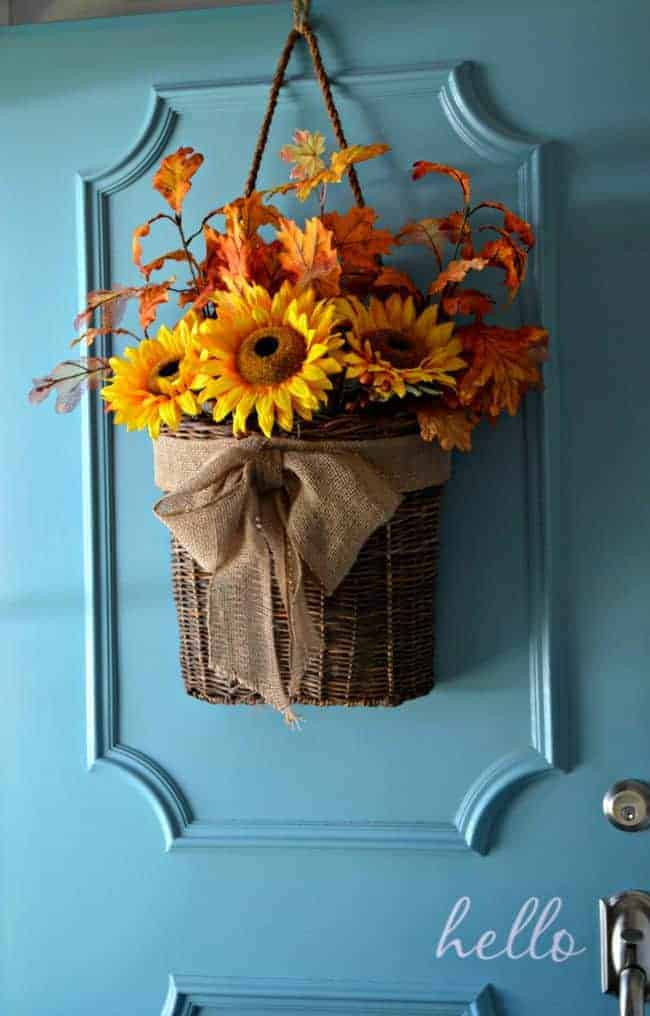 An easy fall DIY front door basket hanging on a turquoise front door