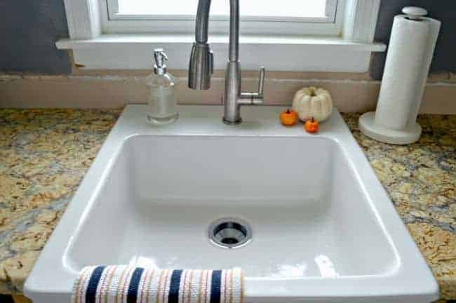 Getting rid of the stainless steel sink and installing a beautiful white farmhouse sink in our new kitchen. | chatfieldcourt.com