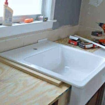 A kitchen with a sink and a new counter