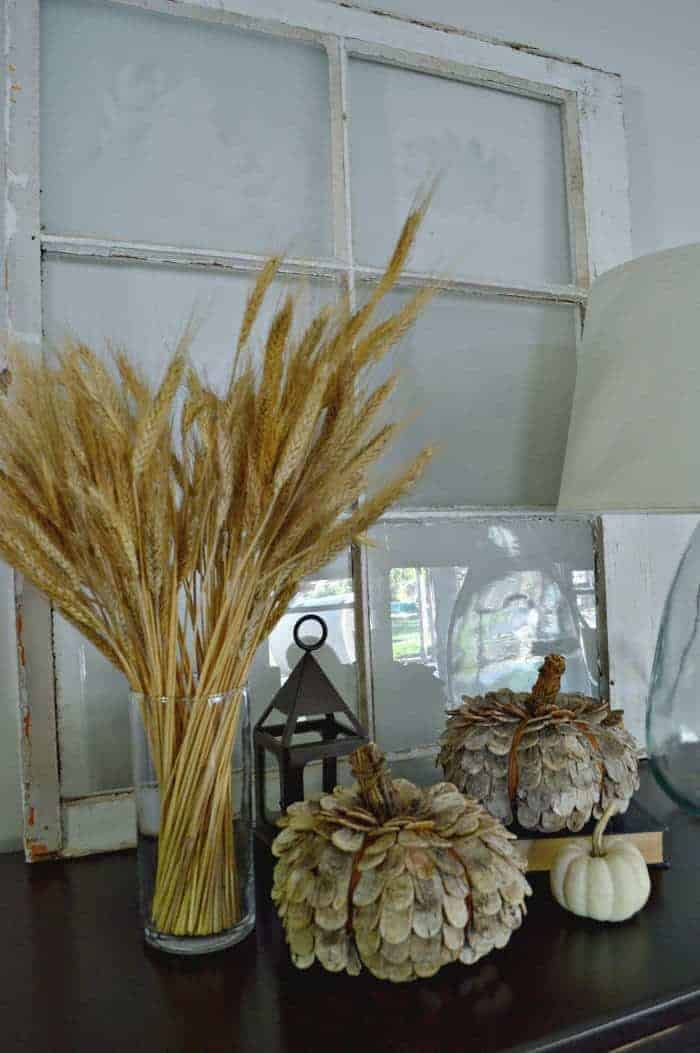 Pretty fall vignette with wheat stalks, a lantern and natural rustic pumpkins from Target. | chatfieldcourt.com