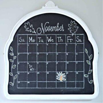 mirror turned DIY chalkboard with a calendar on it